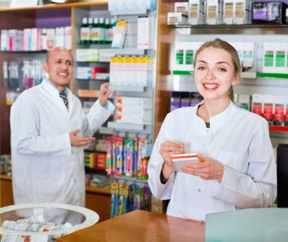 Friendly professional pharmaceutists at drugstore