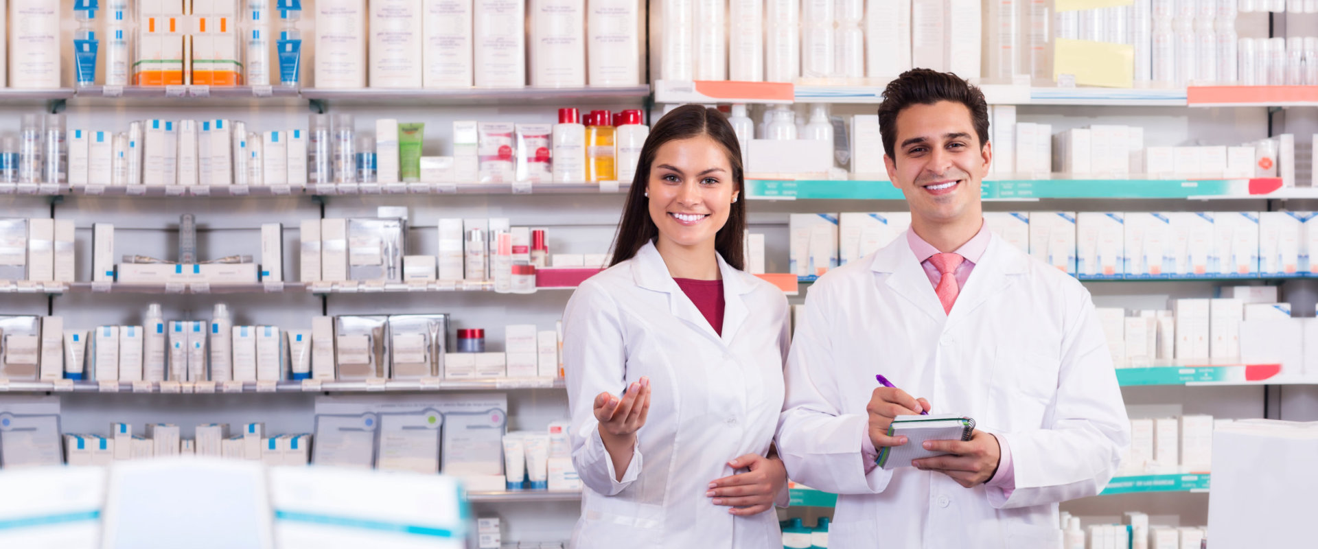 Smiling pharmacist and techician at the pharmacy