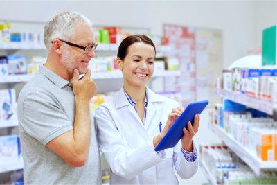 Senior man and a Pharmacist on a tablet pc