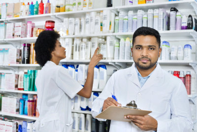 Male pharmacist holding clipboard